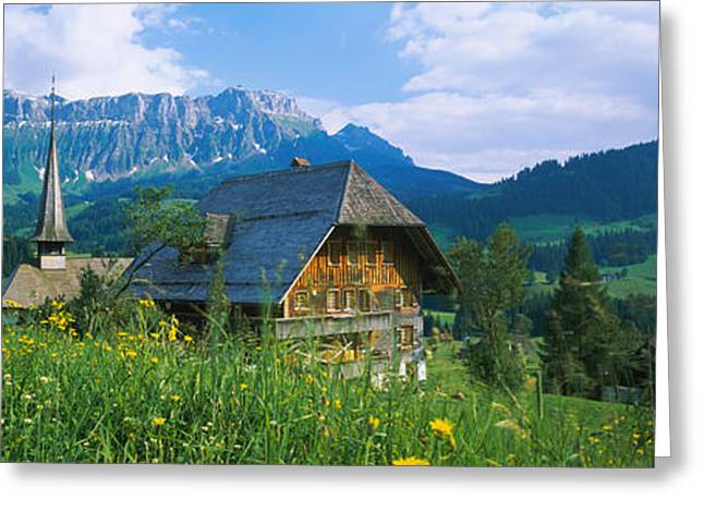 Chalet Greeting Cards - Chalet And A Church On A Landscape Greeting Card by Panoramic Images