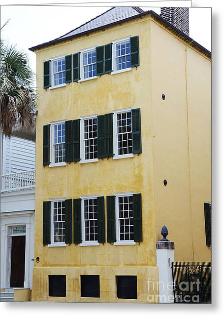 Rainbow Row Greeting Cards - Charleston French Quarter Historical District Yellow House With Black Shutters - Historical Building Greeting Card by Kathy Fornal