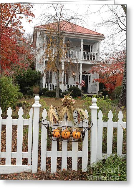 Photographs With Red. Greeting Cards - Charleston Historical Victorian Mansion - Charleston Autumn Fall Trees and White Picket Fence Greeting Card by Kathy Fornal