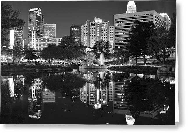 Downtown Charlotte Nc Greeting Cards - Charlotte Reflecting in Black and White Greeting Card by Frozen in Time Fine Art Photography