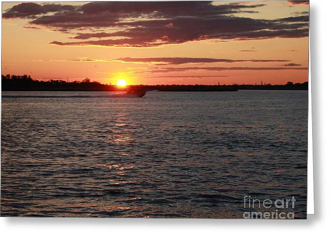 Reflection Of Sun In Clouds Greeting Cards - Chasing The Freeport Sunset Greeting Card by John Telfer