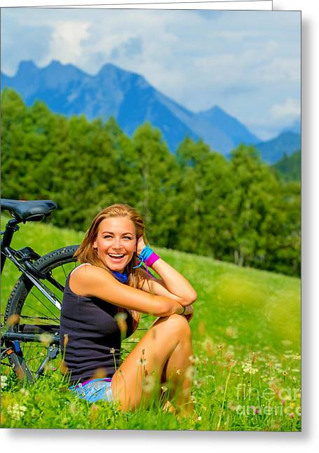 Pushbike Greeting Cards - Cheerful female with bicycle on green field Greeting Card by Anna Omelchenko