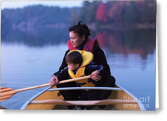Canoe Greeting Cards - Child learning to paddle canoe Greeting Card by Oleksiy Maksymenko