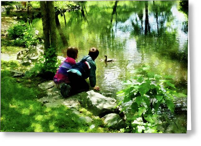 Children And Ducks In Park Greeting Card by Susan Savad