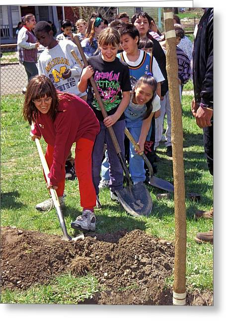 Children Planting A Tree For Earth Day Greeting Card by Jim West