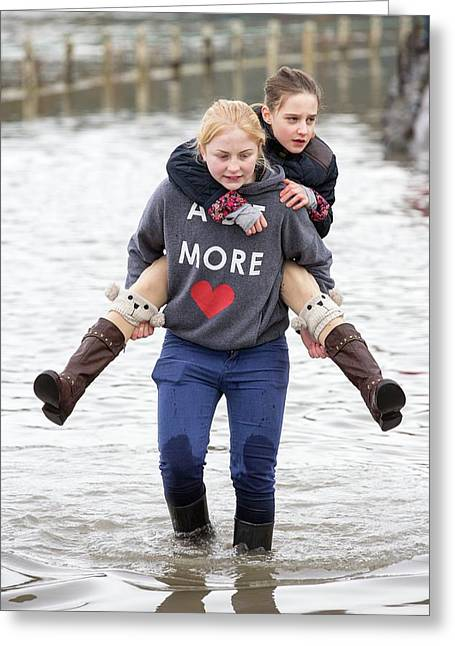 Children Wade Through Flood Waters Greeting Card by Ashley Cooper