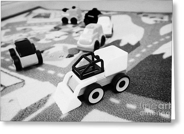 Child Toy Greeting Cards - Childs Toy Cars And Construction Set On A Road Playmat Greeting Card by Joe Fox