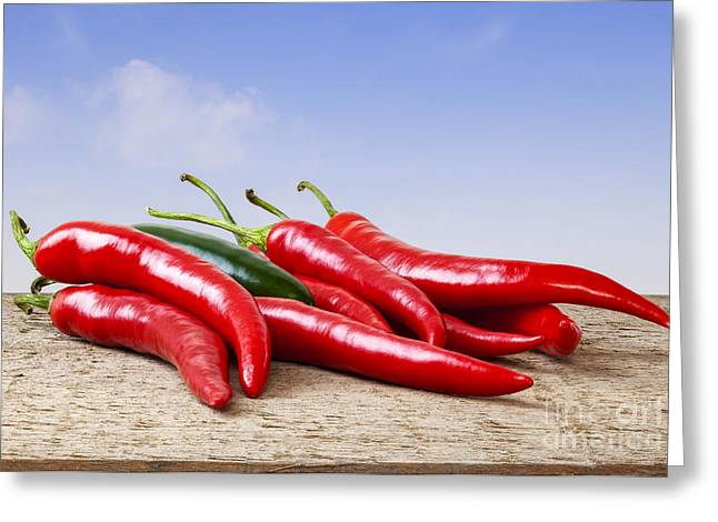Chilli Greeting Cards - Chilli Peppers on Rustic Background Greeting Card by Colin and Linda McKie