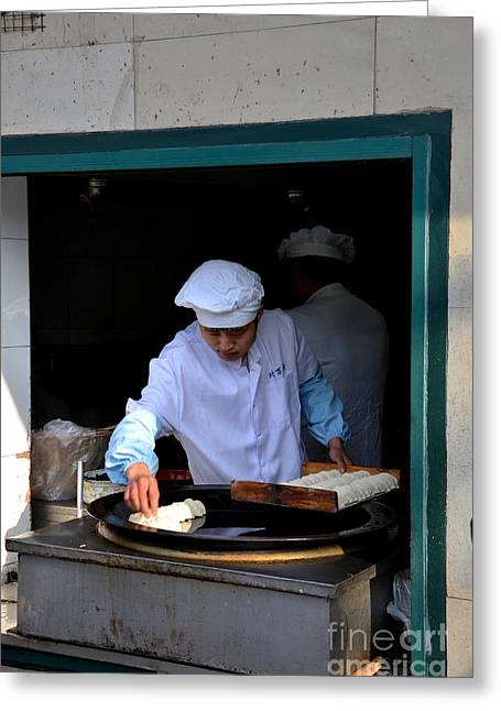 Grey Robe Greeting Cards - Chinese chef cooks food on outdoor skillet Shanghai China Greeting Card by Imran Ahmed