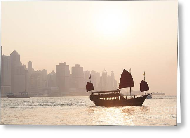 Kowloon Greeting Cards - Chinese junk boat sailing in Hong Kong harbor Greeting Card by Matteo Colombo