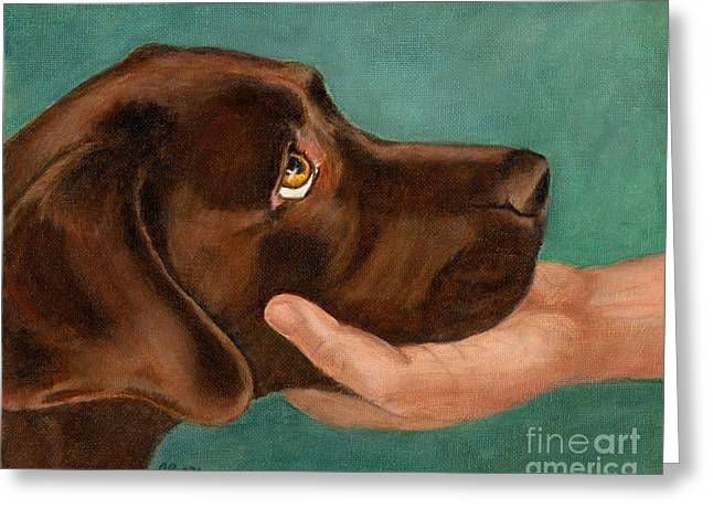 Chocolate Lab Head In Hand Greeting Card by Amy Reges
