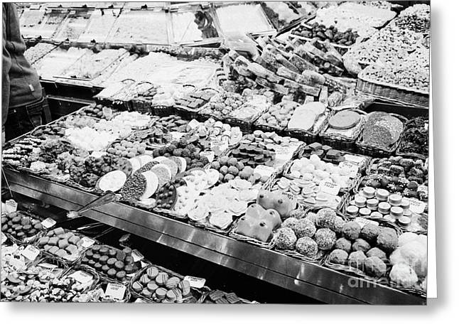chocolates on display inside the la boqueria market in Barcelona Catalonia Spain Greeting Card by Joe Fox