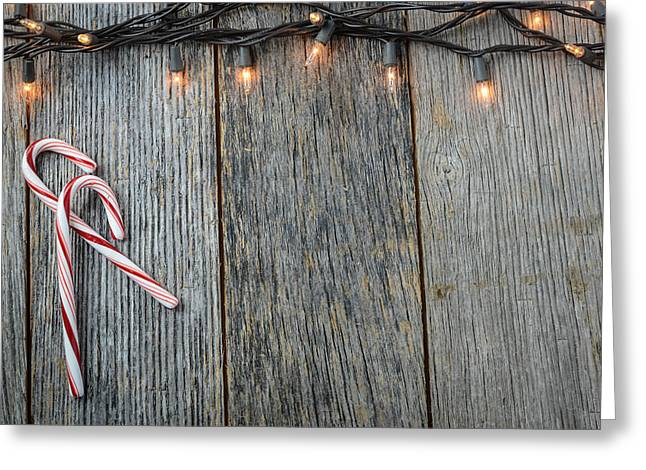 Recently Sold -  - Old Barns Greeting Cards - Christmas Lights and Candy Canes on Rustic Wood Background Greeting Card by Brandon Bourdages