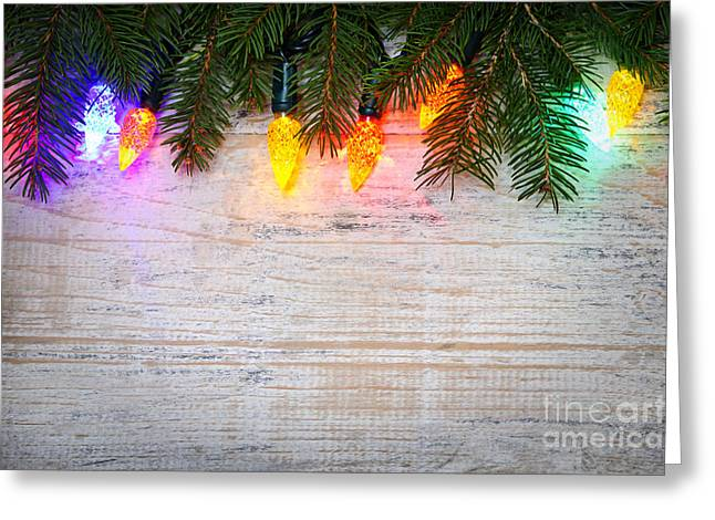 Christmas Lights Greeting Cards - Christmas lights with pine branches Greeting Card by Elena Elisseeva