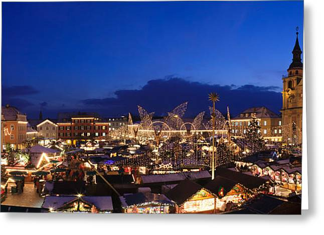 Christmas Market Greeting Cards - Christmas Market Lit Up At Night Greeting Card by Panoramic Images
