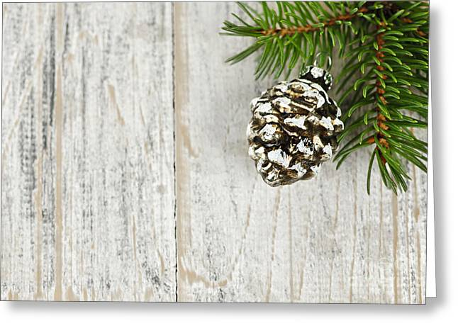 Pine Cone Greeting Cards - Christmas ornament on pine branch Greeting Card by Elena Elisseeva