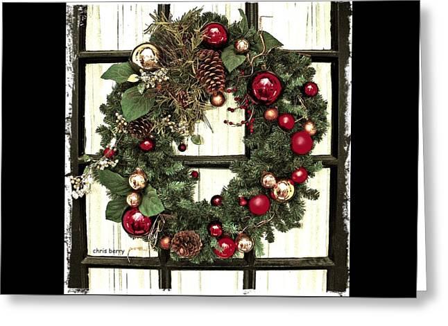 Christmas Wreath On Black Door Greeting Card by Chris Berry