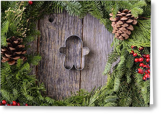 Wood Cutters Greeting Cards - Christmas Wreath with Gingerman Cookie in the Middle of Wood Bac Greeting Card by Brandon Bourdages