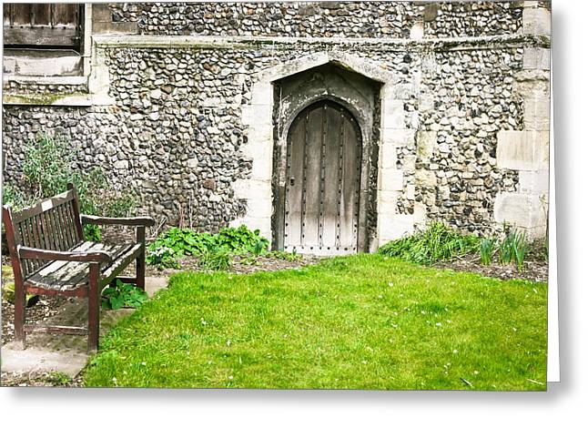 Medieval Entrance Photographs Greeting Cards - Church garden Greeting Card by Tom Gowanlock