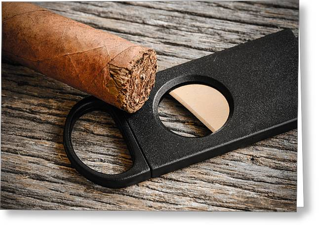 Satisfaction Greeting Cards - Cigar and Cigar Cutter on Rustic Wood Background Greeting Card by Brandon Bourdages