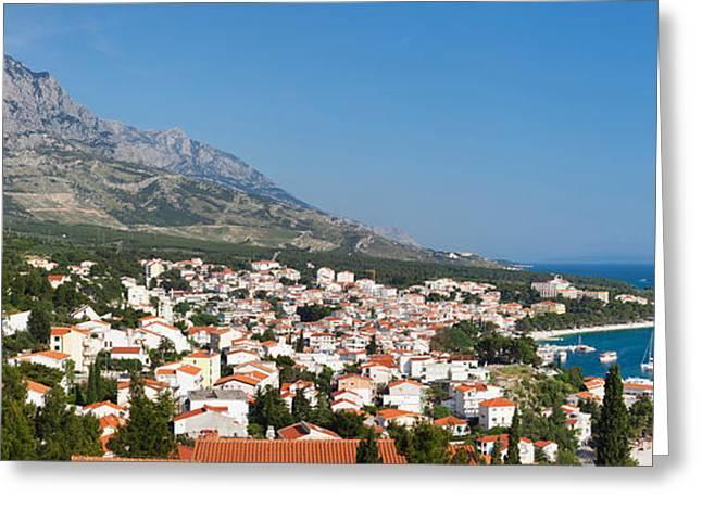 Adriatic Sea Greeting Cards - City At Coast, Baska Voda, Biokovo Greeting Card by Panoramic Images