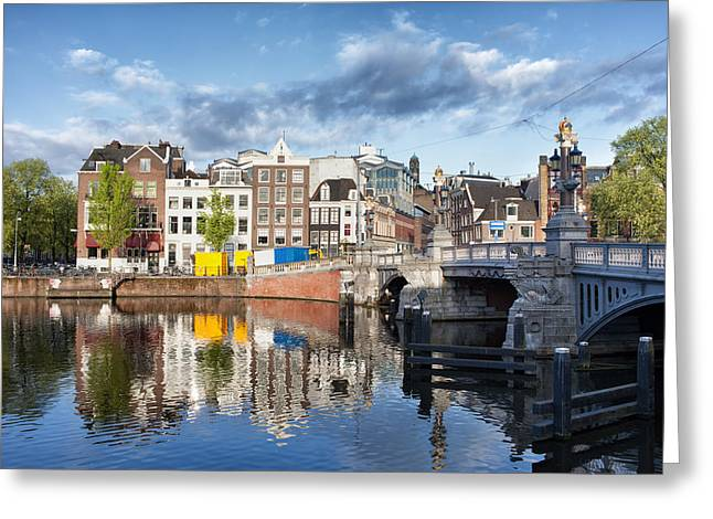 Historic Architecture Greeting Cards - City of Amsterdam by the Amstel River Greeting Card by Artur Bogacki