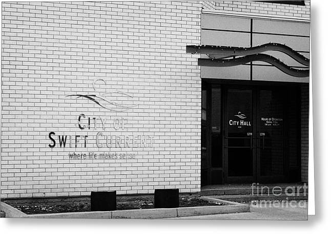 City Hall Greeting Cards - city of swift current city hall with where life makes sense logo Saskatchewan Canada Greeting Card by Joe Fox