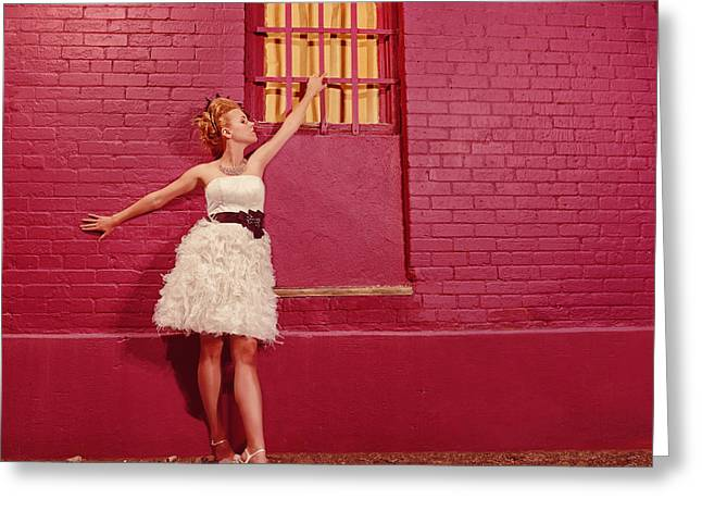 Updo Greeting Cards - Classy Diva Standing In Front Of Pink Brick Wall  Greeting Card by Kriss Russell