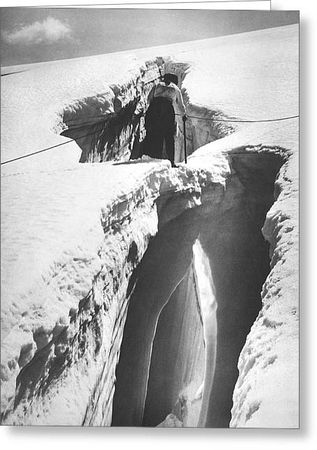 Climber Crossing An Ice Bridge Greeting Card by Underwood Archives