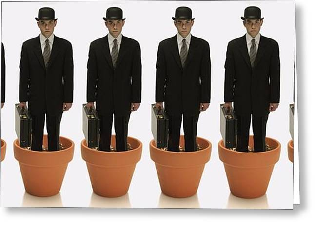 Visual Metaphor Greeting Cards - Clones Of Man In Business Suit Standing Greeting Card by Darren Greenwood