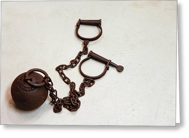 Close Up Of A Ball And Chain Shackles Greeting Card by Julien Mcroberts
