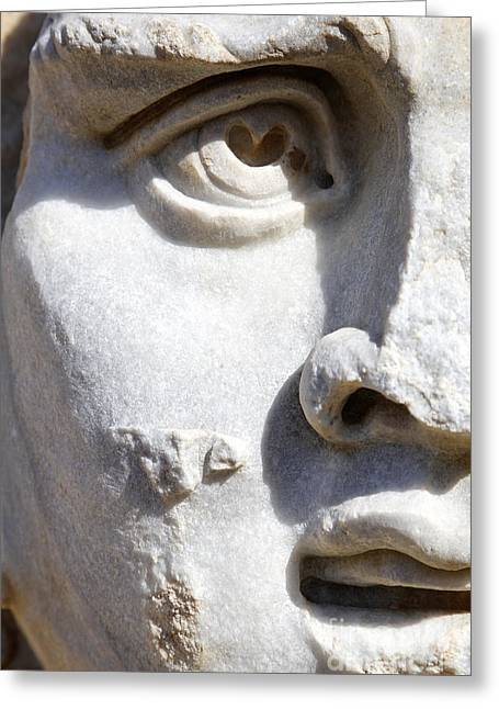 Medusa Greeting Cards - Close up of a Sculpted Medusa head at the Forum of Severus at Leptis Magna in Libya Greeting Card by Robert Preston