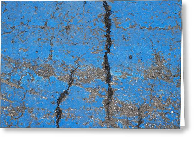 Close Up Of Cracks On A Blue Painted Greeting Card by Perry Mastrovito