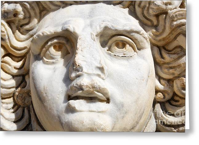 Medusa Greeting Cards - Close up of Sculpted Medusa head at the Forum of Severus at Leptis Magna in Libya Greeting Card by Robert Preston
