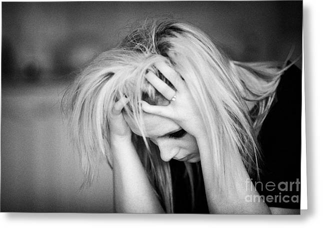 Despair Greeting Cards - Close Up Of The Head And Shoulders Of Young Blonde Haired Teenage Woman Sitting With Head In Her Han Greeting Card by Joe Fox
