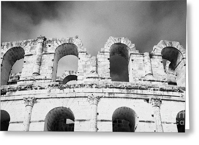 African Heritage Greeting Cards - Close Up Of The Top Of The Old Roman Colloseum Against Blue Cloudy Sky El Jem Tunisia Greeting Card by Joe Fox