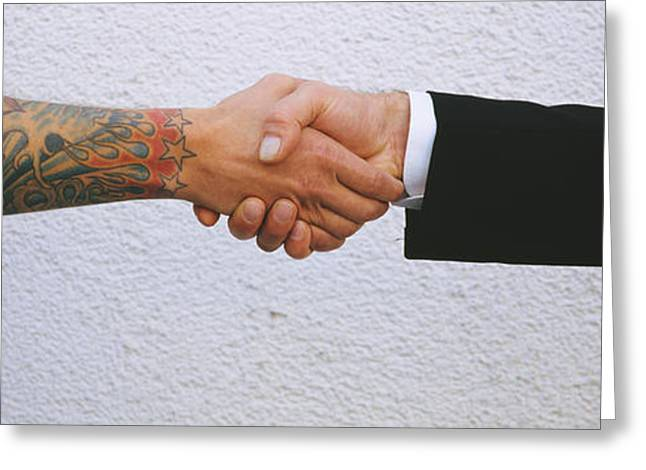 Cooperation Greeting Cards - Close-up Of Two Men Shaking Hands Greeting Card by Panoramic Images