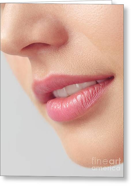 Chin Up Photographs Greeting Cards - Closeup of woman mouth with pink lips Greeting Card by Oleksiy Maksymenko