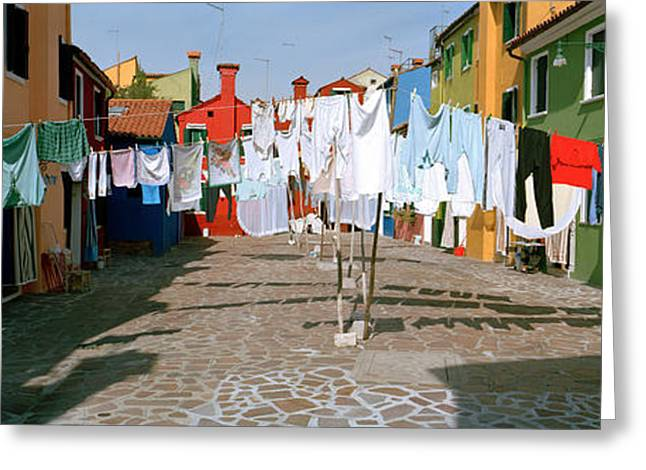 Residential Structure Greeting Cards - Clothesline In A Street, Burano Greeting Card by Panoramic Images