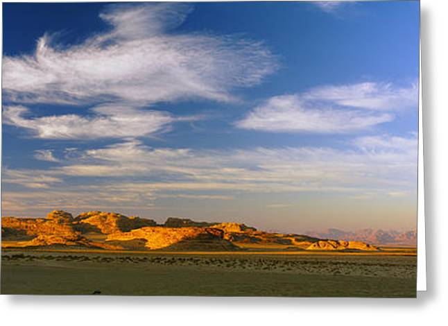 Jordan Photographs Greeting Cards - Clouds Over A Desert, Jordan Greeting Card by Panoramic Images