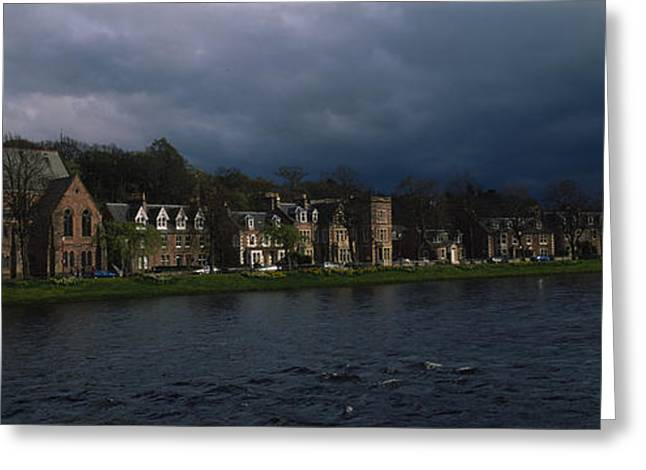 Residential Structure Greeting Cards - Clouds Over Building On The Waterfront Greeting Card by Panoramic Images