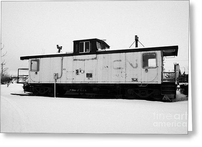 Caboose Photographs Greeting Cards - CN Caboose at CN Trackside gardens used as a community project Kamsack Saskatchewan Canada Greeting Card by Joe Fox