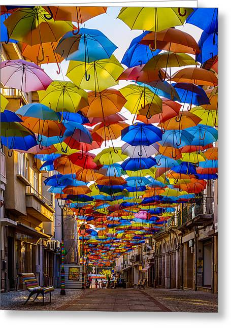 Colorful Floating Umbrellas Greeting Card by Marco Oliveira