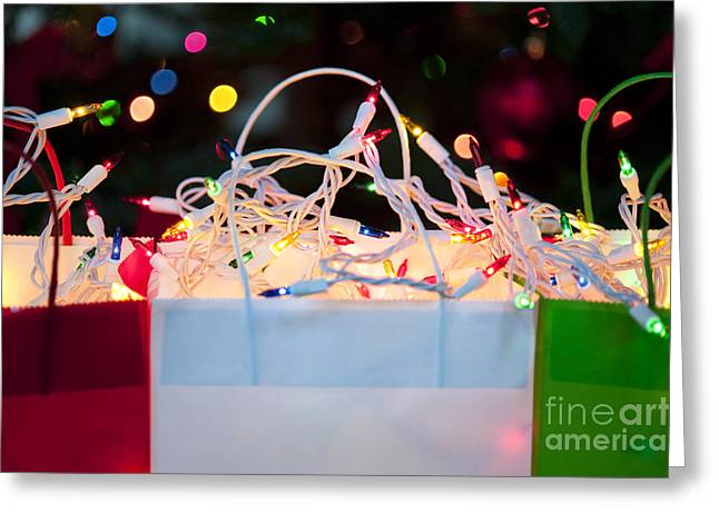 Shopping Bag Greeting Cards - Colorful Gift Bags With Christmas Lights Greeting Card by Jim Corwin