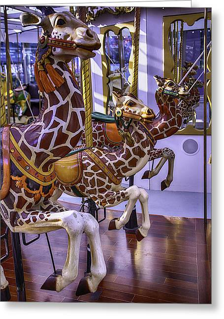 Colorful Giraffes Carrousel Greeting Card by Garry Gay