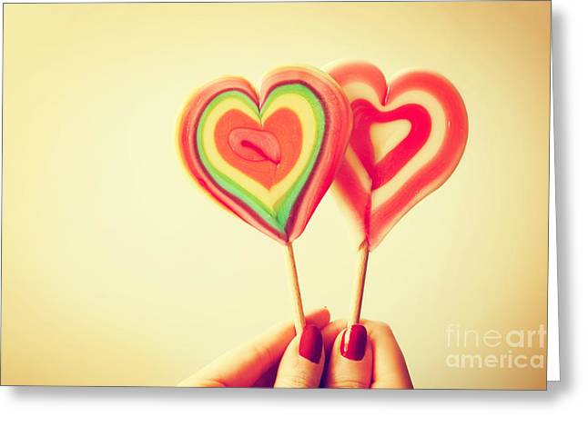 Two Handed Greeting Cards - Colorful heart shaped lollipops in woman hand Greeting Card by Michal Bednarek