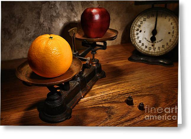Comparing Apple and Orange Greeting Card by Olivier Le Queinec