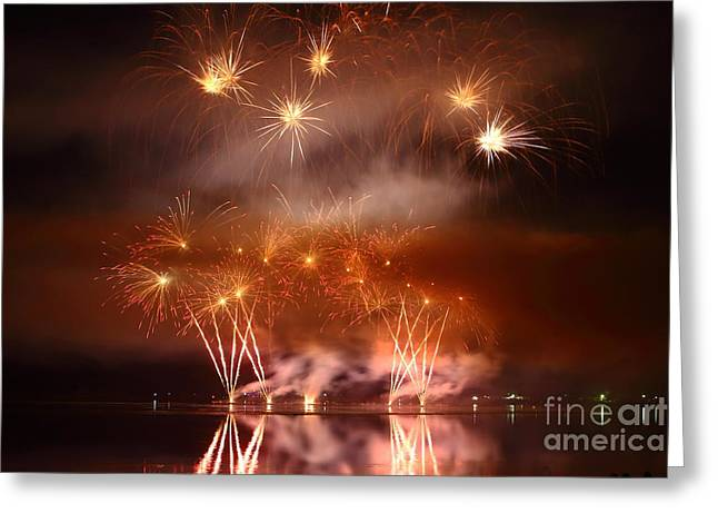 Pyrotechnics Greeting Cards - Copper colored fireworks display on lake Greeting Card by Gregory DUBUS
