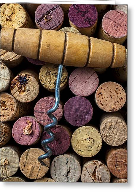 Stopper Photographs Greeting Cards - Corkscrew on top of wine corks Greeting Card by Garry Gay