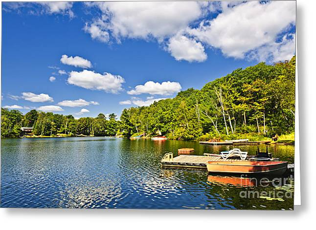 Cottages Photographs Greeting Cards - Cottages on lake with docks Greeting Card by Elena Elisseeva
